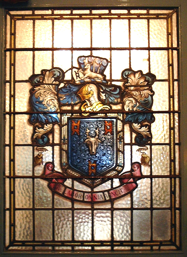 The large stained glass window has the crest and motto of the Town Improvement Commissioners