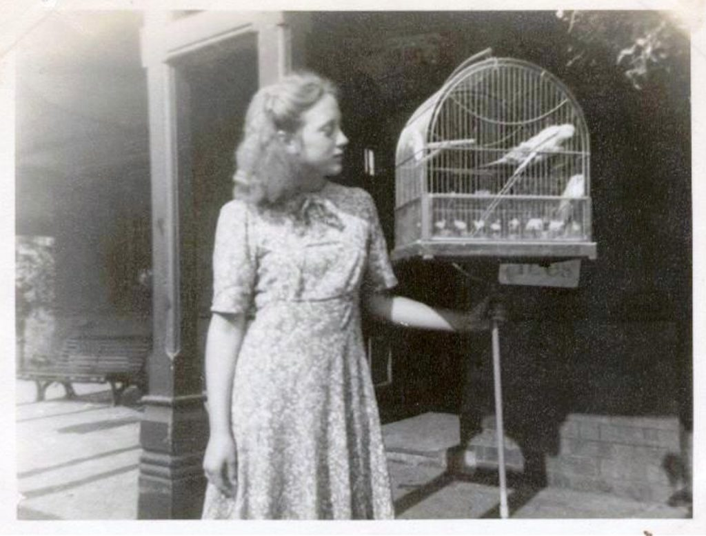 Shirley Flood nee Johnson outside the refreshment rooms in 1948 with the famous Hill Mynah bird Joe Johnson taught to say very loudly 'Up the Baggies'